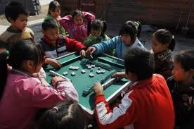 Kids playing Mahjong in China